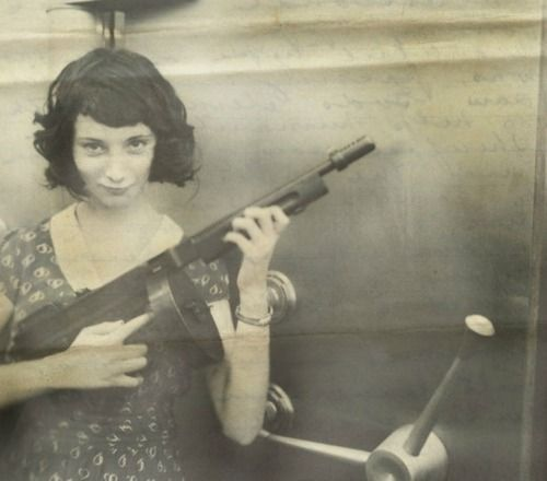 Madam Moll, Gangster from The Late 20's with her M1928 Thompson in front of a bank safe she just robbed…